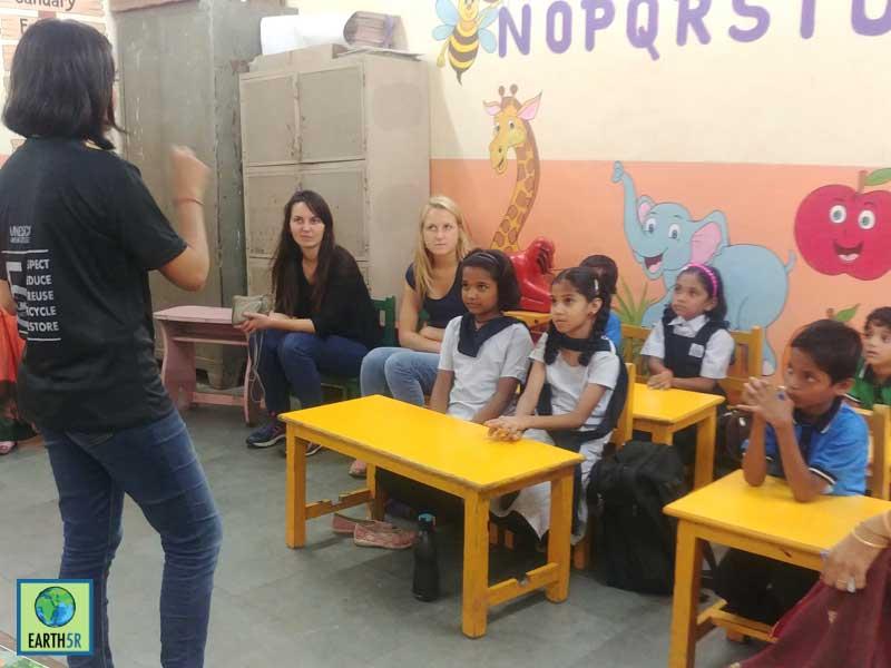 volunteer teaching children about waste segregation Mumbai India Environmental NGO Earth5R