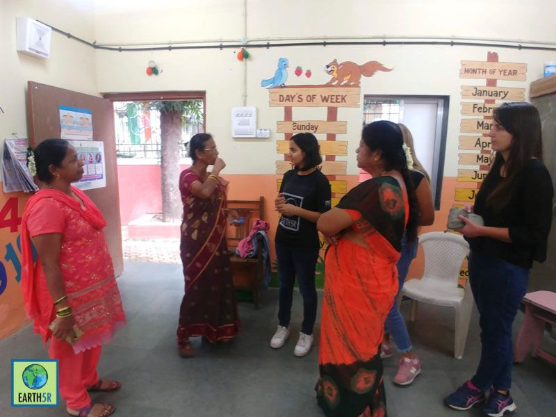 volunteers discuss with teachers Mumbai India Environmental NGO Earth5R